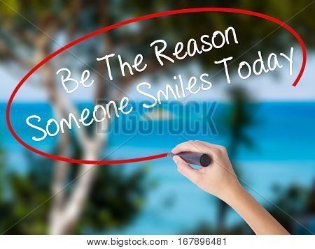 Woman Hand Writing Be The Reason Someone Smiles Today  With Black Marker On Visual Screen