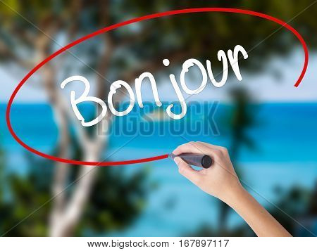 Woman Hand Writing Bonjour  (good Morning In French) With Black Marker On Visual Screen