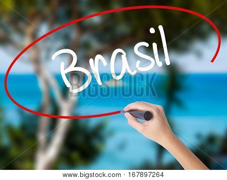 Woman Hand Writing Brasil ( Brazil  In Portuguese) With Black Marker On Visual Screen