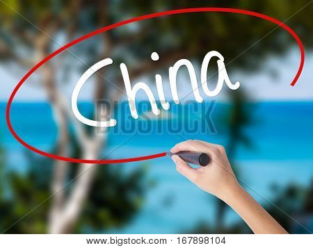 Woman Hand Writing China With Black Marker On Visual Screen