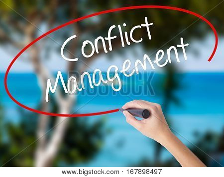 Woman Hand Writing Conflict Management With Black Marker On Visual Screen.