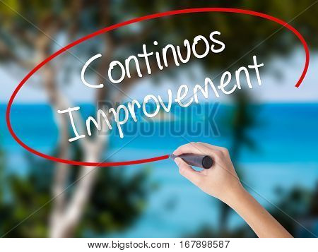 Woman Hand Writing Continuos Improvement With Black Marker On Visual Screen