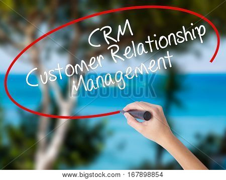 Woman Hand Writing Crm Customer Relationship Management  With Black Marker On Visual Screen