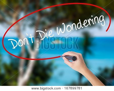 Woman Hand Writing Don't Die Wondering With Black Marker On Visual Screen