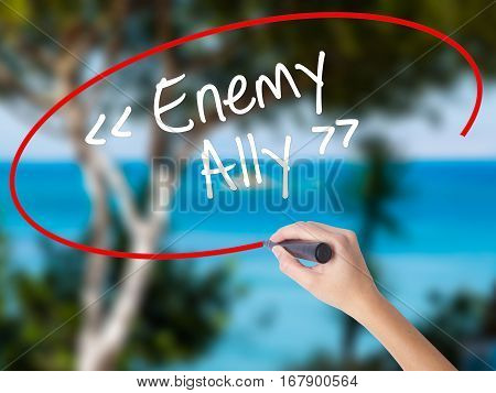 Woman Hand Writing Enemy - Ally With Black Marker On Visual Screen.