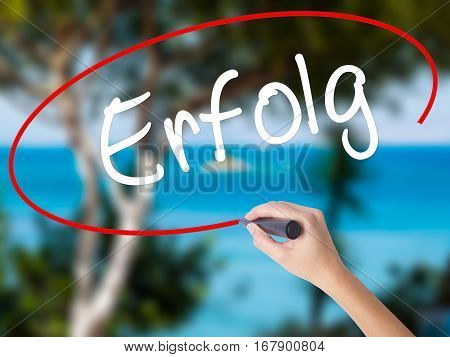 Woman Hand Writing Erfolg Success (in German) With Black Marker On Visual Screen