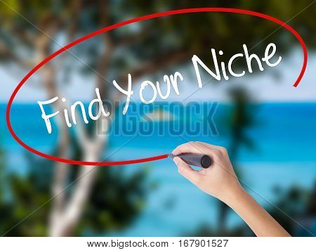 Woman Hand Writing Find Your Niche With Black Marker On Visual Screen