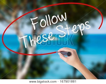 Woman Hand Writing Follow These Steps With Black Marker On Visual Screen