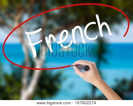 Woman Hand Writing French With Black Marker On Visual Screen