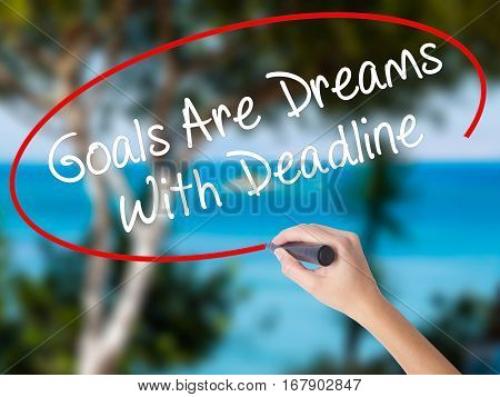 Woman Hand Writing Goals Are Dreams With Deadline With Black Marker On Visual Screen
