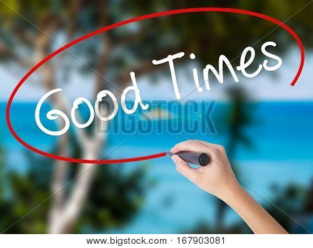 Woman Hand Writing Good Times With Black Marker On Visual Screen