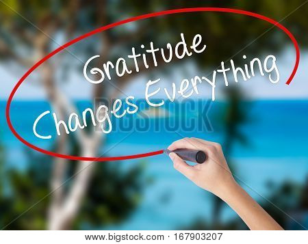 Woman Hand Writing Gratitude Changes Everything With Black Marker On Visual Screen