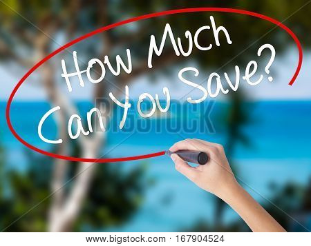 Woman Hand Writing How Much Can You Save? With Black Marker On Visual Screen