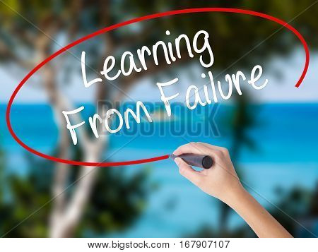 Woman Hand Writing Learning From Failure With Black Marker On Visual Screen.
