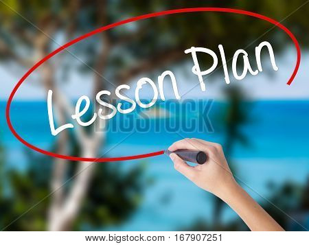 Woman Hand Writing Lesson Plan With Black Marker On Visual Screen