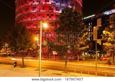 Barcelona Spain - January 04 2017: Colorful luminous street of Barcelona near the Agbar tower in the night