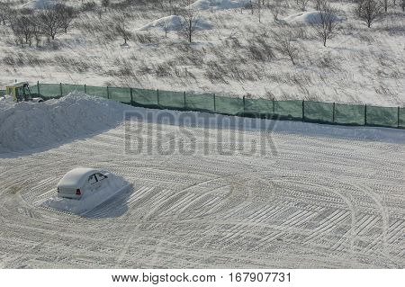 Car left alone in the company parking after massive snowfall