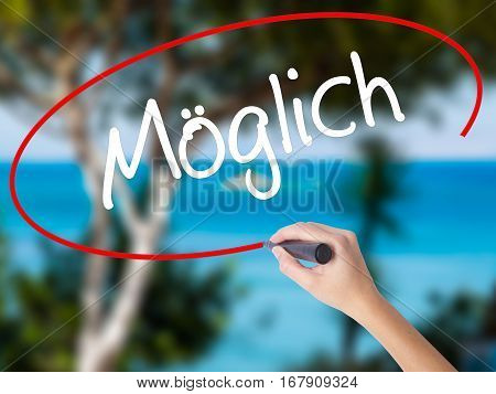 Woman Hand Writing Moglich (possible In German) With Black Marker On Visual Screen.
