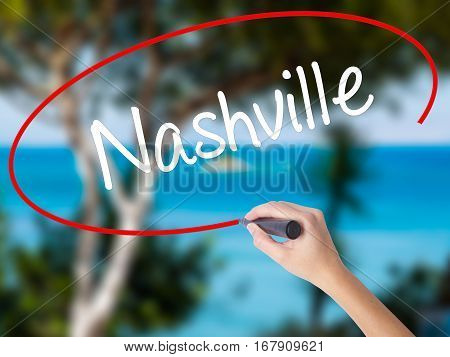 Woman Hand Writing Nashville With Black Marker On Visual Screen
