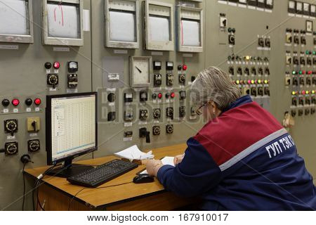 ST. PETERSBURG, RUSSIA - DECEMBER 16, 2016: Person on duty in the control station of the boiler plant Parnas. It is the largest heat energy source in Northern Europe