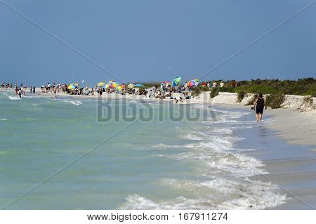 Sanibel Island, Florida, USA - February 25, 2011: Beachgoers enjoying a sunny winter day on Sanibel Island