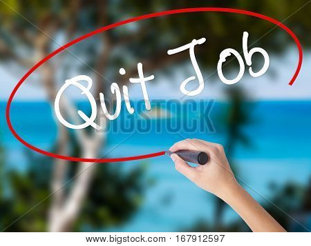 Woman Hand Writing Quit Job With Black Marker On Visual Screen