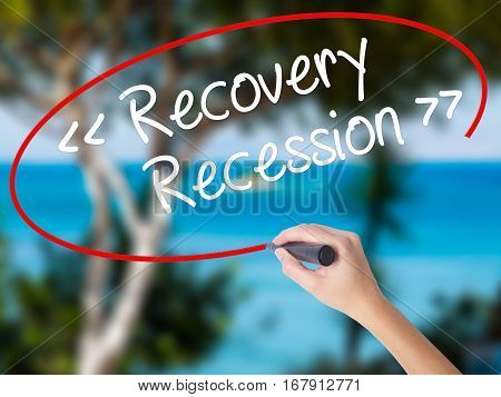 Woman Hand Writing  Recovery - Recession With Black Marker On Visual Screen
