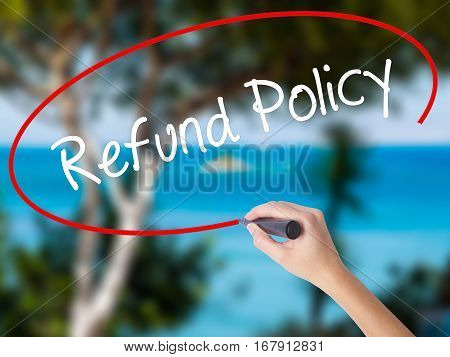 Woman Hand Writing Refund Policy With Black Marker On Visual Screen
