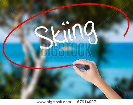 Woman Hand Writing Skiing With Black Marker On Visual Screen