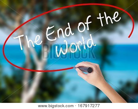 Woman Hand Writing The End Of The World With Black Marker On Visual Screen