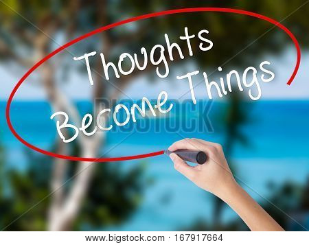 Woman Hand Writing Thoughts Become Things With Black Marker On Visual Screen
