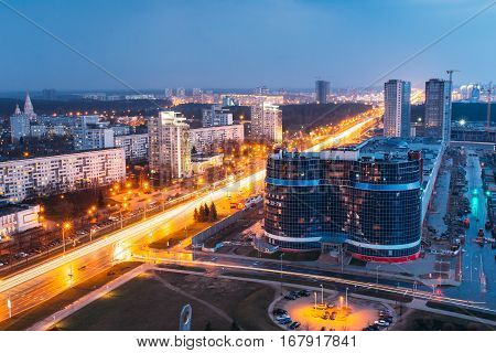 Minsk, Belarus - April 6, 2016: Aerial View Cityscape In Bright Blue Hour Evening And Yellow Illumination Spring Twilight. Construction Of Building Dana Mall In Independence Avenue