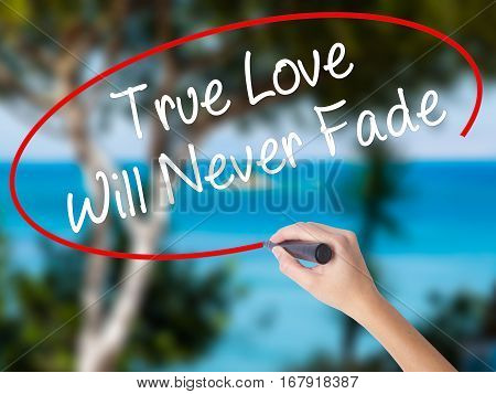 Woman Hand Writing True Love Will Never Fade With Black Marker On Visual Screen