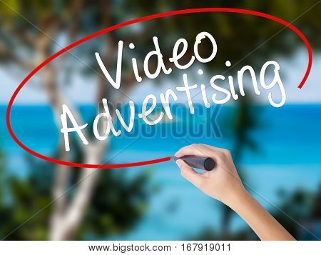 Woman Hand Writing Video Advertising With Black Marker On Visual Screen