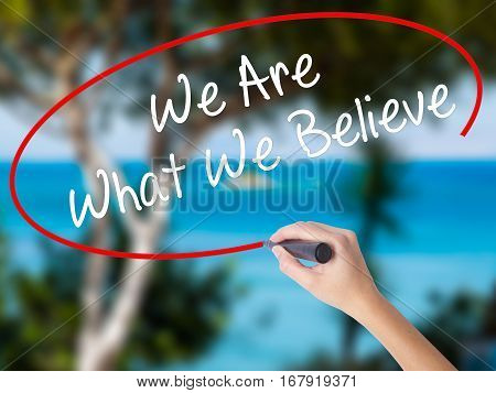 Woman Hand Writing We Are What We Believe With Black Marker On Visual Screen