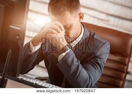 Tired Business Man At Workplace In Office Holding His Head On Hands. Sleepy Worker Early In The Morn