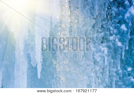 beautiful blue ice and frozen icicles closeup winter background