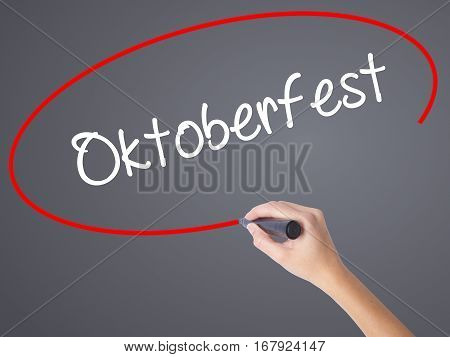 Woman Hand Writing Oktoberfest With Black Marker On Visual Screen