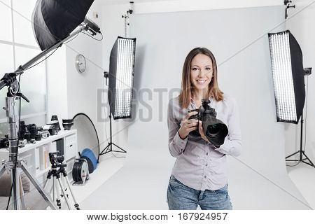 Young Female Photographer In The Studio