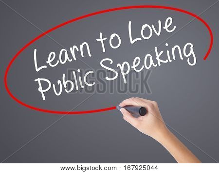 Woman Hand Writing Learn To Love Public Speaking With Black Marker On Visual Screen