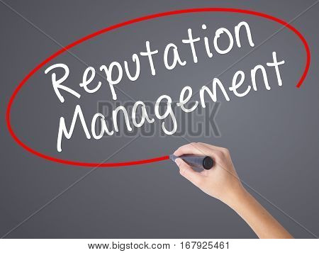 Woman Hand Writing Reputation Management With Black Marker On Visual Screen