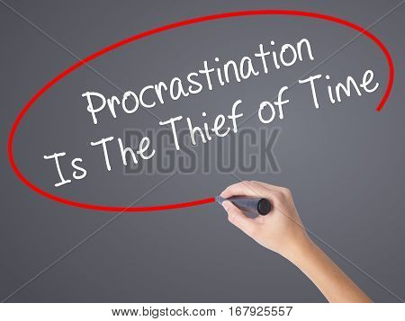 Woman Hand Writing  Procrastination Is The Thief Of Time With Black Marker On Visual Screen