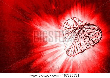 Heart shape frame being bonded and beaming light on red background