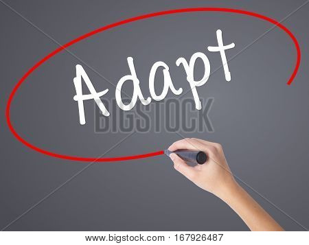 Woman Hand Writing Adapt With Black Marker On Visual Screen