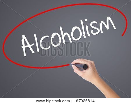 Woman Hand Writing Alcoholism With Black Marker On Visual Screen.