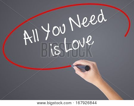 Woman Hand Writing All You Need Is Love With Black Marker On Visual Screen