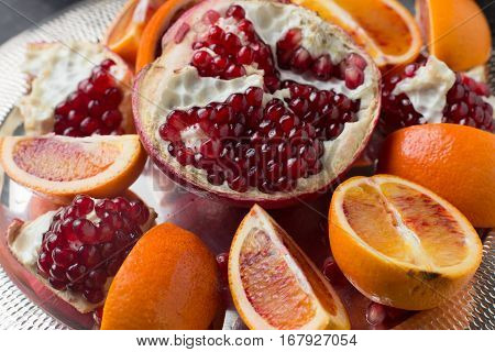 Red Juicy Pomegranate On Dark Marble Background. Healthy, Antioxidant, Fresh, Gourmet, Delicious, Or