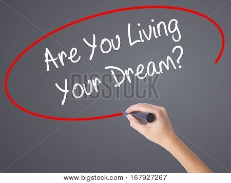 Woman Hand Writing Are You Living Your Dream? With Black Marker On Visual Screen