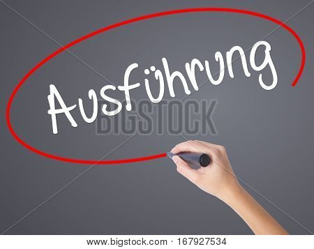 Woman Hand Writing Ausfuhrung (execution In German) With Black Marker On Visual Screen