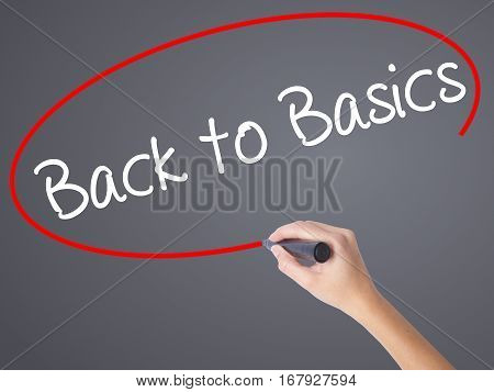 Woman Hand Writing Back To Basics With Black Marker On Visual Screen